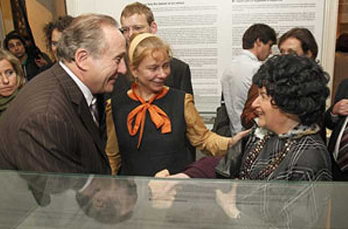 A guest at the exhibit opening tells Michael Reagan how she escaped East Berlin.